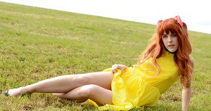 Amarna Miller poses in a beautiful yellow dress while outside