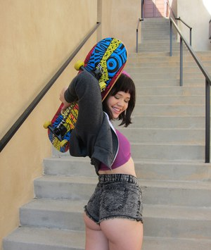 Raunchy skating asian babe undressing on stairways without any fear