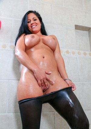 Beautiful curvy Latina babe Missy Maze poses her sexy oiled body