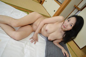 Tsuyako Miyataka spreads her mature hairy Asian pussy after undressing