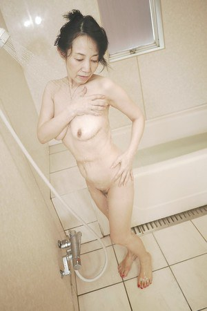 Tsuyako Miyataka is an Asian mature lady getting wet in the shower