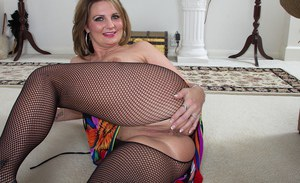 Mature lady in pantyhose Cherrie Dixon spreads her sexy legs