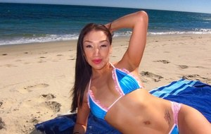 Amateur asian sweetie Vicki Chase posing on the beach in a bikini