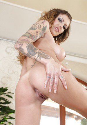 Busty milf Carolina Monro is an inked up slut you would love to bang