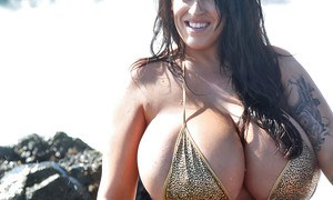 Euro pornstar Leanne Crow showing off her big juggs outdoors