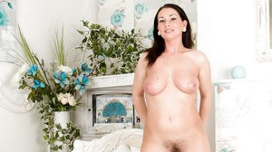 Spreading her legs milf Annabella Ford reveals her hairy crotch