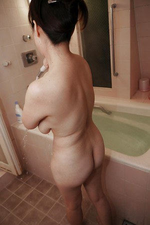 Asian hottie Masae Hamae takes a bath cleaning her nice big tits
