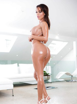 Brunette babe Franceska Jaimes baring her big breasts an oiled butt
