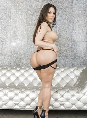 Latina babe Aleska Nicole posing solo in high heels and showing ass