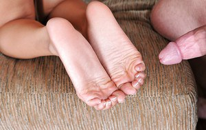 A footjob given by Asian brunette Angelina Chung with a foot fetish
