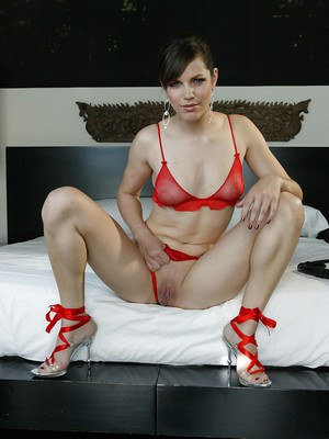 Bobbi Starr in high heels and lingerie spreading her sexy legs