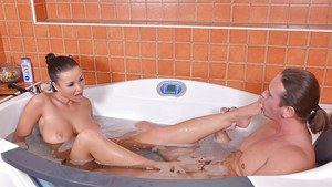 European teen Patty Michova taking a bath and giving a footjob