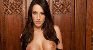 Shaved brunette babe and housewife Kortney Kane is sexy in stockings