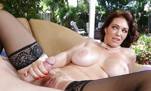 Close ups of Milf Charlee Chase giving handjob and blowing dick