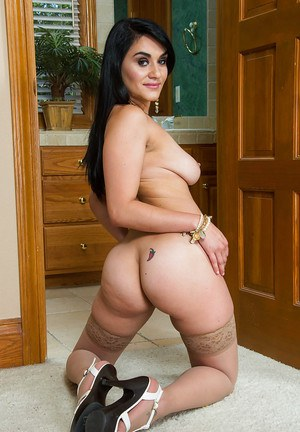 Brunette Latina babe Charley Chase in high heels baring firm rump
