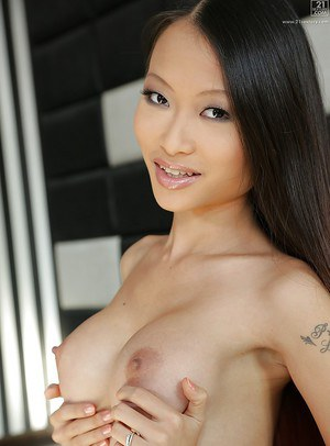 Asian babe Pussykat fingers own ass and fondle big natural tits