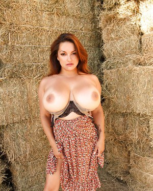 Big tit Milf Monica Mendez posing and stripping out of skirt outdoors