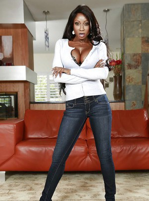 Mature ebony Diamond Jackson in denim jeans posing her big tits