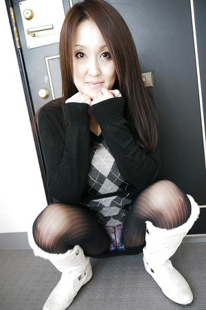Asian brunette Riko Kariya posing for non nude shots in boots and hose