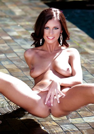 After playing in the pool pornstar Whitney Westgate fingers her pussy