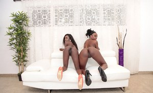 Horny ebony babes Naomi Gamble and Molleuex Au Chocolat pose in heels