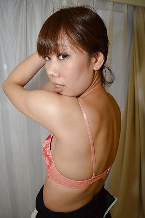 Asian brunette Ayami Nishino displays her plump rear and hairy pussy