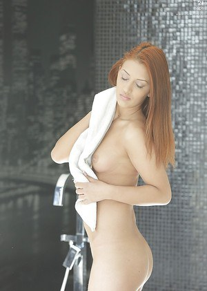 Pornstar babe Aylin Diamond drying her red hair after a bath