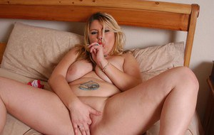 Tattooed blonde fatty Amy showing off her ample big fat breasts