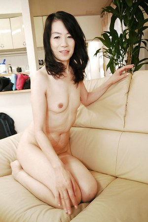 Mature Asian lady Yukiko Asaba stripping out of nylons to masturbate