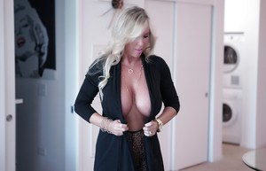 Blonde babe Sandra Otterson playing with perky nipples and big juggs