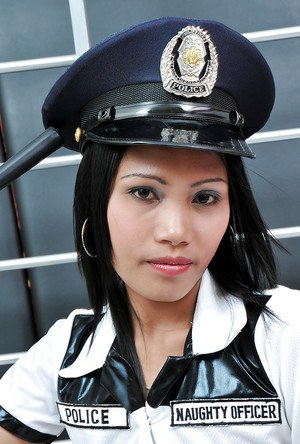 Brunette Latina babe Rose looking sexy half naked in police uniform