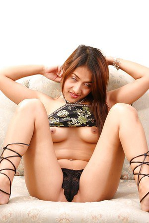 Cute Oriental strips off panties to masturbate hairy Asian twat