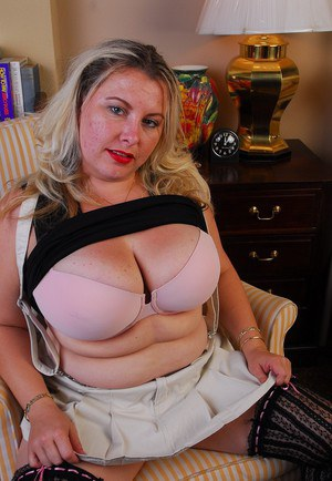 Big boobed blonde BBW Tawni exposing her stockings and panties