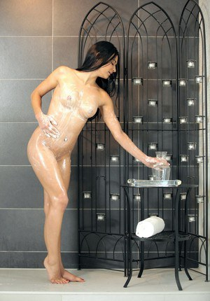 Nasty babe Adele pisses in the shower and cleans it up with her tongue