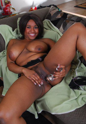 Lewd ebony mature Aleera plays with her tits while dildoing her pussy