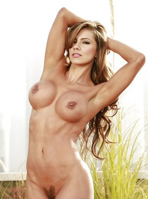 Muscle chick Esperanza Gomez exposing her big knockers outdoors