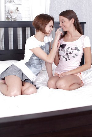 Euro lesbians Dila and Foxy Di kissing in schoolgirl clothes