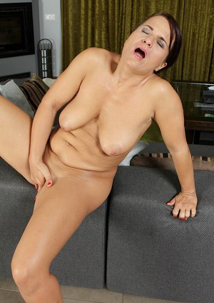 Saggy boobed mature woman Katherine Ross masturbating her pussy