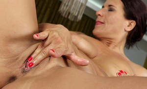 Chubby older woman Katherine Ross spreads her shaved pink kitty wide