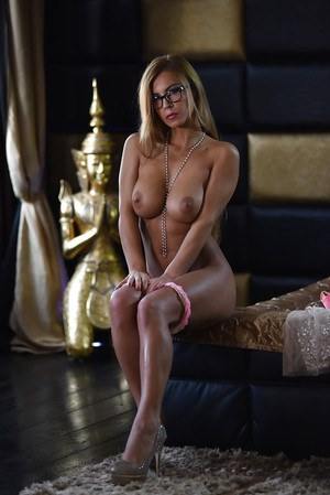 Busty blonde babe Dorothy posing in pink underwear and glasses