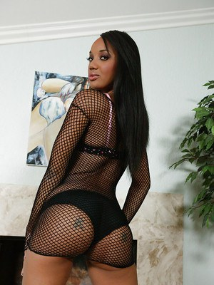 Sexy black chick posing non-nude phat booty in see thru mesh dress