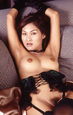 Hot Thai chick in seductive lingerie playing with all natural tits