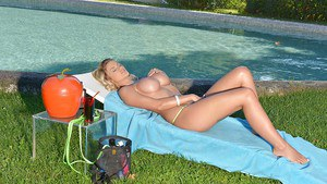 Busty blonde Candy Sexton letting her massive knockers loose outdoors