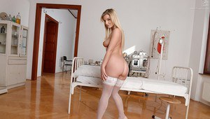 Euro babe Jemma Valentine posing in sexy nurse uniform and stockings