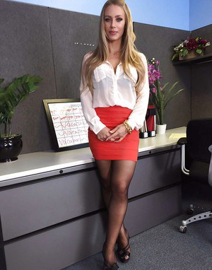 Office secretary Nicole Aniston flashing long legs and ass at work