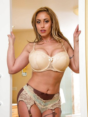 Fantastic MILF with great hooters Eva Notty exposes her delicious body