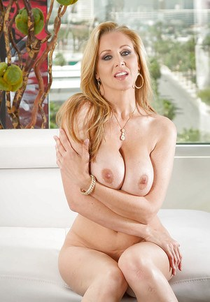 Large boobed mom Julia Ann playing with her incredible pair of tits