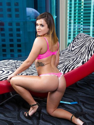 Tattooed cutie Keisha Grey models her naked young body in high heels