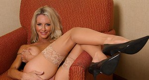 Busty blonde mom Emma Starr playing with massive tits and masturbating