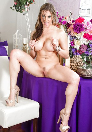 Naughty MILF Rachel Roxxx poses for some naked shots at a wedding